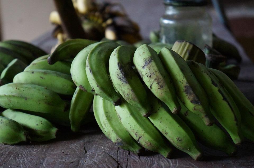 Five Green potatoes and bananas